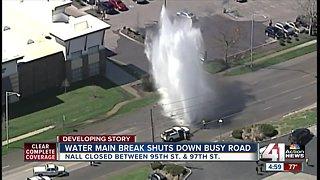 Massive water main break shuts down Nall Avenue at 95th Street