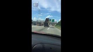 Driver Witnesses Dump Truck Crash Into Highway Sign in Jacinto City, TEXAS