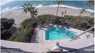 A Kid Jumps Off A Six-Storey Balcony Into A Pool