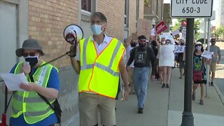Hundreds of Royal Oak protesters gather for 'Save the Post Office' rally