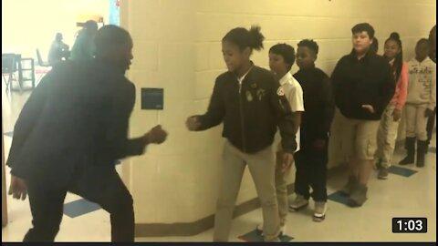 Teacher has incredible handshake with student