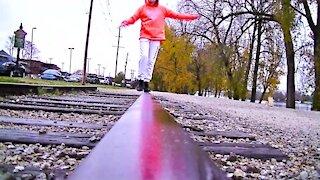 Girl Shows off Amazing Balance on Train Tracks!