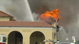 Firefighter injured in massive fire at historic train building in Delray Beach