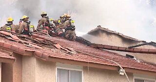 Firefighters respond to 2-alarm apartment fire in central Las Vegas