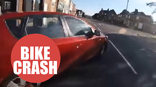 Cyclist nearly collides with a car after a reckless driver sharply pulls out