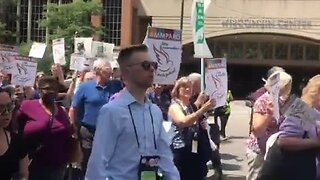 Hundreds protest President Trump's immigration policies in downtown Milwaukee Wednesday