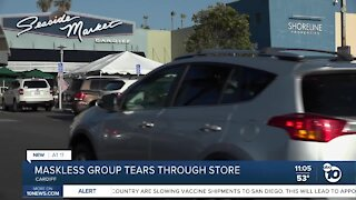 Maskless group tears through store