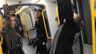 Young woman falls off metro onto platform