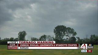 Tornado north of De Soto wrapped in rain