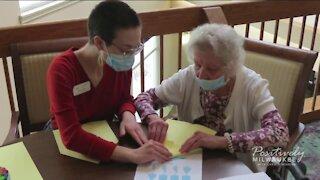 College students living with senior citizens celebrate graduation