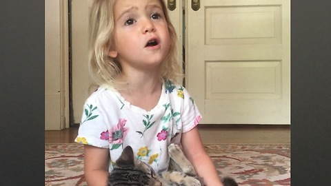 Toddler And Kitten Sing 'Somewhere Over The Rainbow'