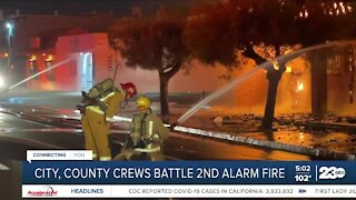 City, county crews battle two alarm fire