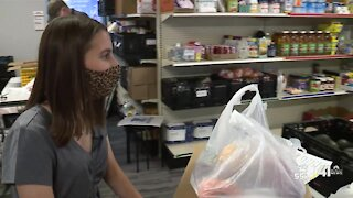 Graduate recognized for years of dedication to food pantry
