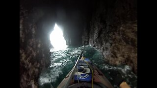 Kayaking through the caves of the Arch Rock