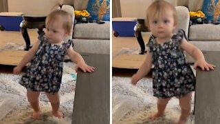 Baby girl preciously dances to 'Footloose' theme song