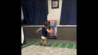 Cute babies playing basketball