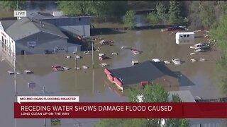 Receding water shows damage flood caused