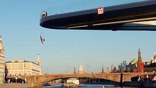Russian Thrillseeker Hangs From Floating Bridge In Moscow