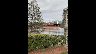 Huge ship going down the river