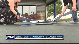 Local business changing handicapped parking for ADA anniversary