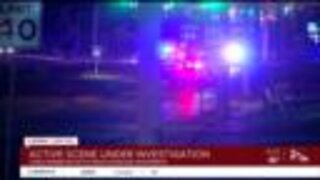 Manhunt underway after two officers shot