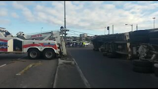 Cyclist rescued from under truck (pgY)