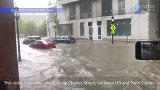 Drivers attempt to navigate through flooded areas on Charles Street