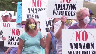 Dozens protest Amazon plans outside of Grand Island Town Hall