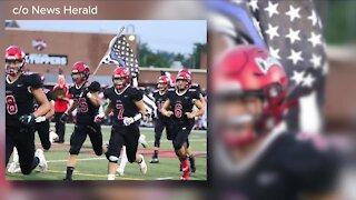 Chardon Local Schools bans 'thin blue line' flag after football player carries it on field