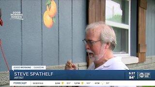 Local artist paints oranges on hundreds of Dunedin homes