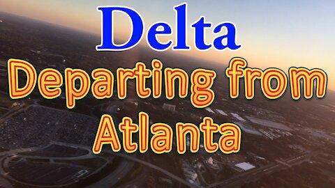 Delta flight departing from Atlanta Airport (ATL) at dusk in McDonnell Douglas MD-85