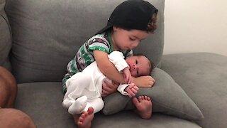 Toddler Preciously Hugs His Newborn Baby Brother
