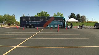 Colorado to open large vaccination sites as employer-mandates begin