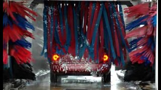 Men take a shower in a car wash