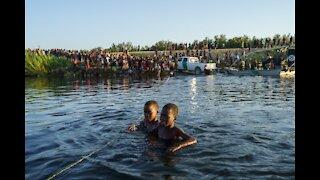 Mayorkas Visits Camp of Illegal Immigrants, Gives Warning