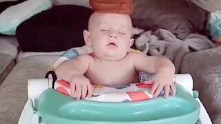 Parents stack food on top of sleeping baby's head