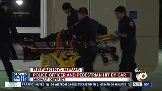 SDPD officer hospitalized after being struck by vehicle in Midway District