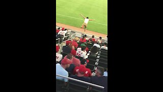 College student runs onto field during Atlanta Braves game