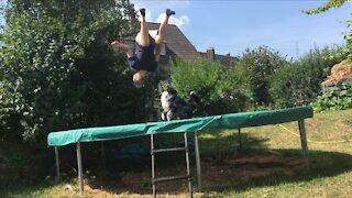 Australian Shepherd and owner having fun on a trampoline
