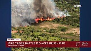 Fire crews battle 160-acre brushfire in Palm Beach Gardens