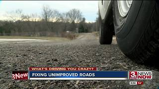 Residents question cost increase to fix unimproved road