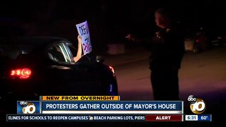 Dozens rally outside mayor's home after budget approval