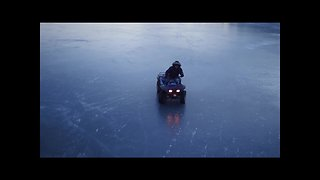 Drone captures ATV riding on a frozen lake in Nova Scotia