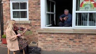 Violinist visits her grandpa in quarantine for musical reunion