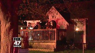 Firefighters battle house fire in Lansing