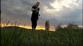 women run with his dog