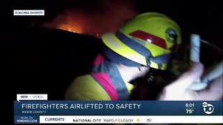 Firefighters airlifted to safety