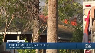 Firefighters battle double house fire in phoenix