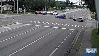 CAUGHT ON VIDEO: Driver zooms through red light, plows into two cars