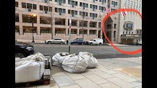 Bricks and Propane tanks on DC sidewalk = just construction material